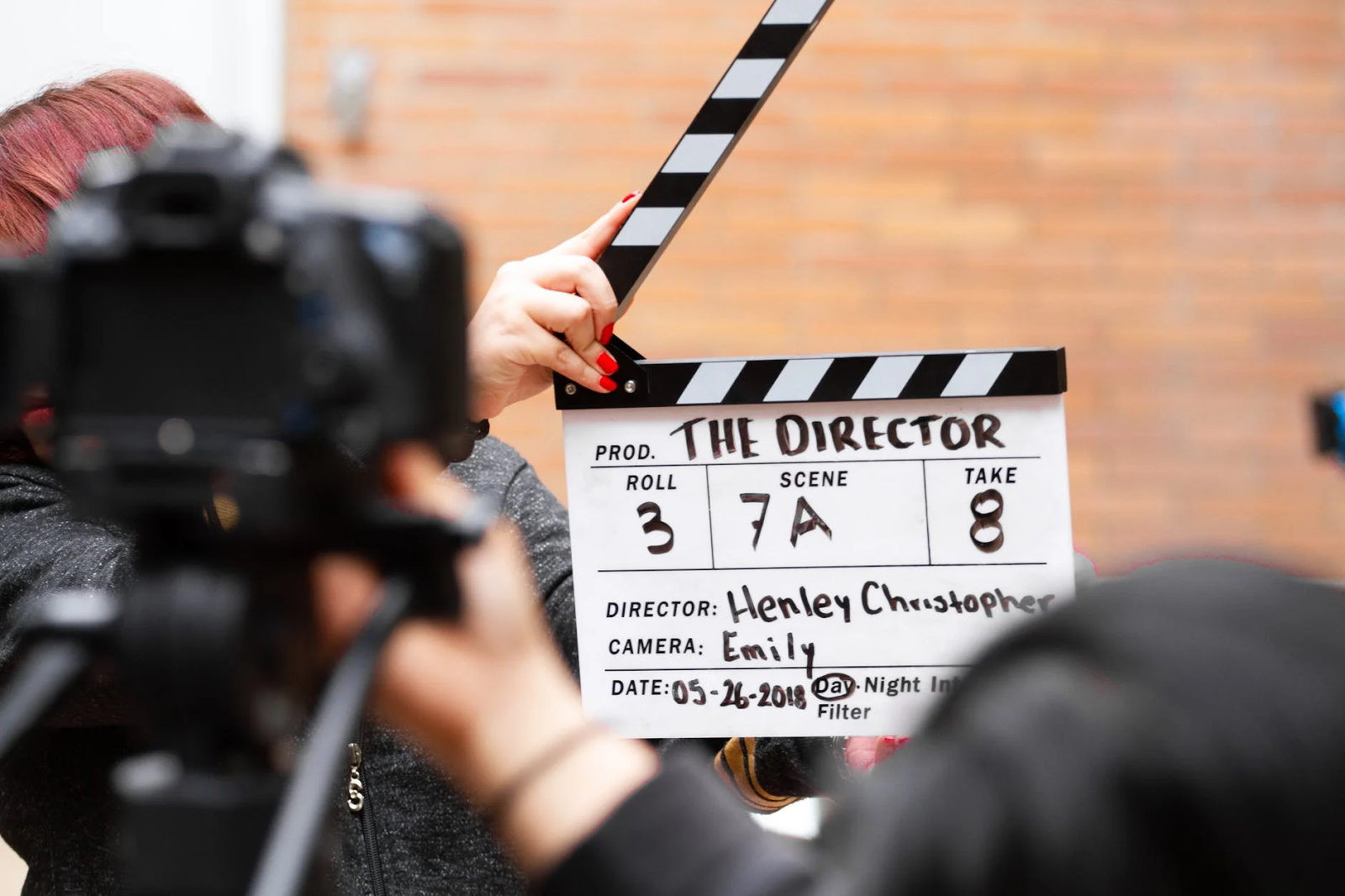 image of a man holding a clapper board
