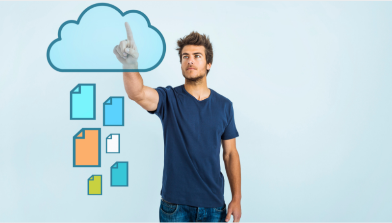 a man pointing an animated cloud based storage with files logo in the  background