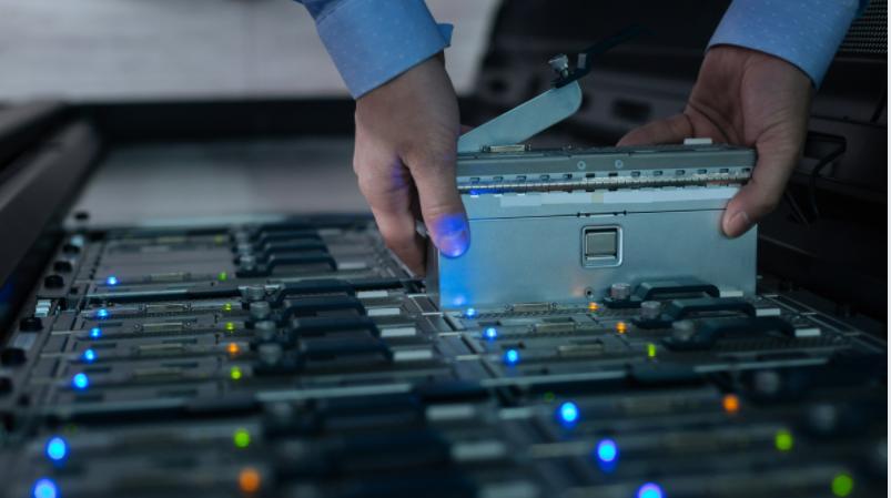 computer-engineer-installing-bland-server-in-data-center