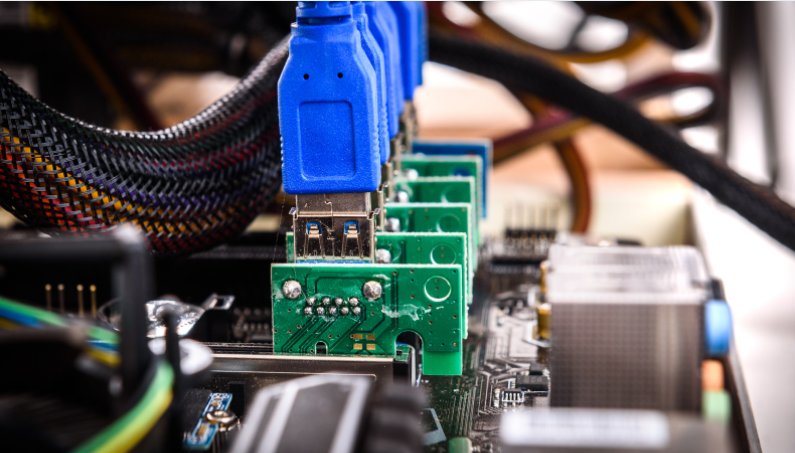 PCIe riser extenders plugged to motherboard stock photo
