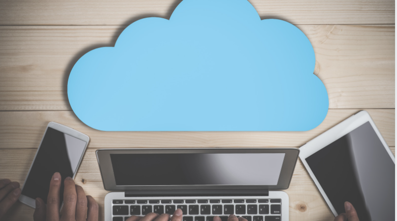 3 gadgets in the desk (phone, tablet, and a laptop) - cloud storage for video editing