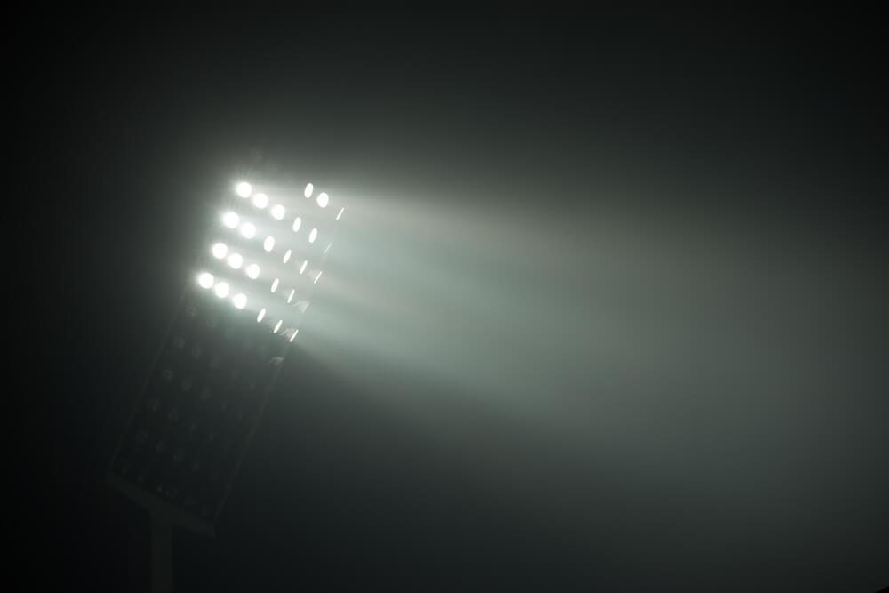 soccer stadium lights reflectors against black background - optimized